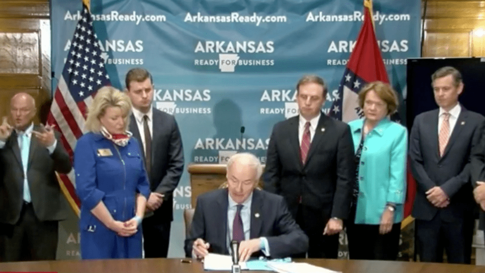 Arkansas governor signs orders protecting businesses from virus liability