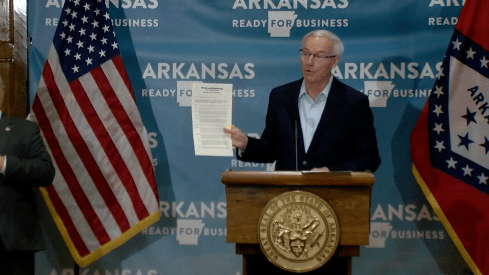 Arkansas governor signs executive order allowing cities to require masks