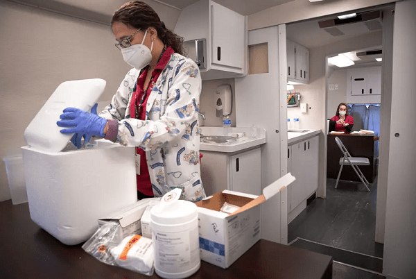 COVID-19 vaccines may be coming soon, but most Texans won't get them for months. Here's why.
